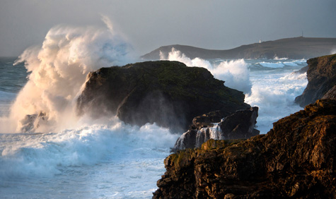 Waves hitting against rocks at Porthcothan Bay